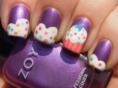 Nail polish is the back drop for these pink and white cupcake nail art